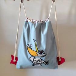 sac à goûter à dos crèche maternelle pélican broderie original pêche créateur tissus cadeau naissance sac à dos personnalisable